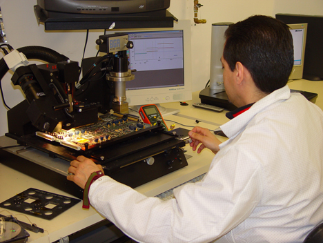 technician performing assembly production